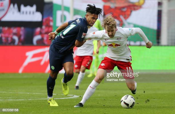 Emil Forsberg of Leipzig battles for the ball with Daniel Didavi of Wolfsburg during the Bundesliga match between RB Leipzig and VfL Wolfsburg at Red...