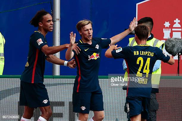 Emil Forsberg of Leipzig celebrates scoring the opening goal with his team mates during the Bundesliga match between Hamburger SV and RB Leipzig at...