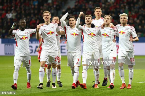 Emil Forsberg of Leipzig celebrates with his team after he scored a penalty goal to make it 12 during the Bundesliga match between Bayer 04...