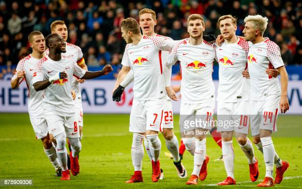 Emil Forsberg of Leipzig celebrates with team mates after scoring his teams second goal during the Bundesliga match between Bayer 04 Leverkusen and...