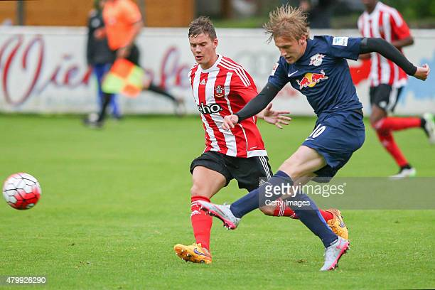 Emil Forsberg of Leipzig is challenged by Cedric Soares of Southampton during the preseason friendly match between RB Leipzig and FC Southampton at...