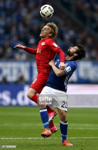 Emil Forsberg of Leipzig is challenged by Coke of Schalke during the Bundesliga match between FC Schalke 04 and RB Leipzig at VeltinsArena on April...