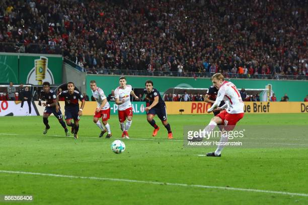 Emil Forsberg of Leipzig scores the opening goal with a penalty during the DFB Cup round 2 match between RB Leipzig and Bayern Muenchen at Red Bull...