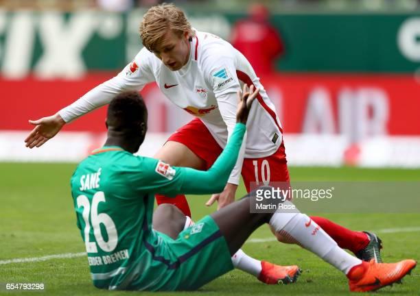 Emil Forsberg of Leipzig tussles with Famine Sane of Bremen during the Bundesliga match between Werder Bremen and RB Leipzig at Weserstadion on March...