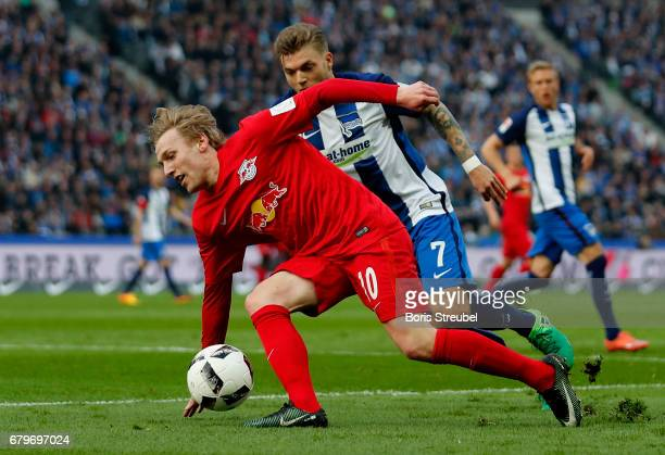 Emil Forsberg of RB Leipzig is challenged by Alexander Esswein of Hertha BSC during the Bundesliga match between Hertha BSC and RB Leipzig at...
