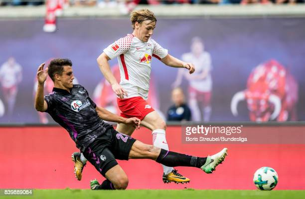 Emil Forsberg of RB Leipzig is challenged by MarcOliver Kempf of SC Freiburg during the Bundesliga match between RB Leipzig and SportClub Freiburg at...