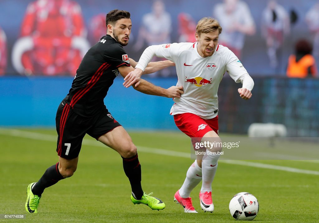 Emil Forsberg of RB Leipzig is challenged by Mathew Leckie of FC Ingolstadt 04 during the Bundesliga match between RB Leipzig and FC Ingolstadt 04 at Red Bull Arena on April 29, 2017 in Leipzig, Germany.