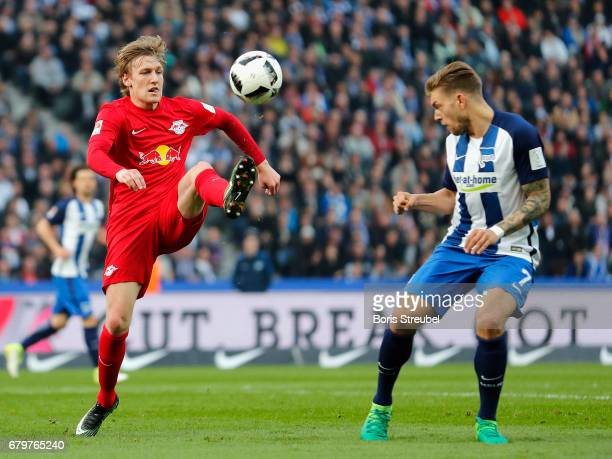 Emil Forsberg of RB Leipzig is challenged by Sebastian Langkamp of Hertha BSC during the Bundesliga match between Hertha BSC and RB Leipzig at...