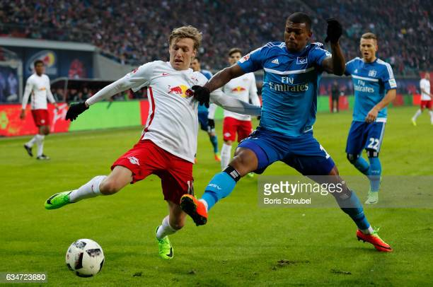 Emil Forsberg of RB Leipzig is challenged by Walace of Hamburger SV during the Bundesliga match between RB Leipzig and Hamburger SV at Red Bull Arena...