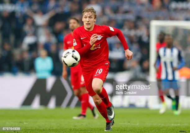 Emil Forsberg of RB Leipzig runs with the ball during the Bundesliga match between Hertha BSC and RB Leipzig at Olympiastadion on May 6 2017 in...