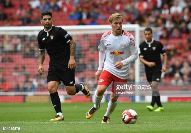 Emil Forsberg of RB Leipzig turns away from Ever Banega of Sevilla during the match RB Leipzig and Sevilla at Emirates Stadium on July 29 2017 in...