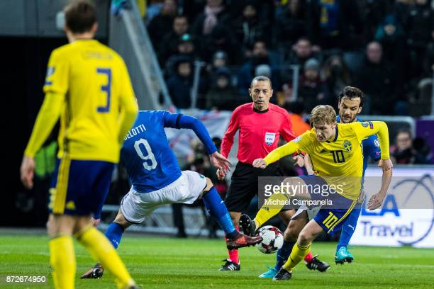 Emil Forsberg of Sweden against Andrea Belotti of Italy during the FIFA 2018 World Cup Qualifier PlayOff First Leg between Sweden and Italy at...