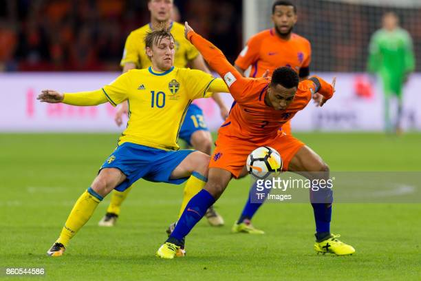 Emil Forsberg of Sweden and Kenny Tete of Netherlands battle for the ball during the FIFA 2018 World Cup Qualifier between Netherlands and Sweden at...