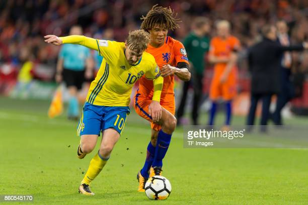 Emil Forsberg of Sweden and Nathan Ake of Netherlands battle for the ball during the FIFA 2018 World Cup Qualifier between Netherlands and Sweden at...
