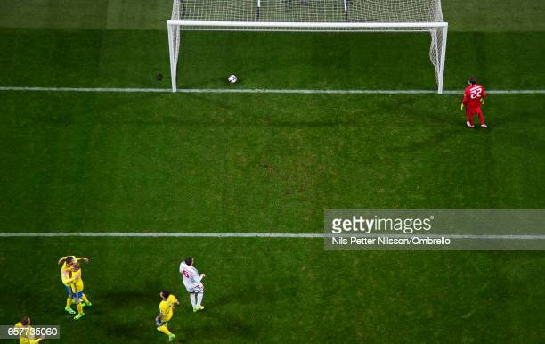 Emil Forsberg of Sweden celebrates after scoring the opening goal to 10 on penalty during the FIFA 2018 World Cup Qualifier between Sweden and...