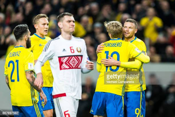 Emil Forsberg of Sweden celebrates scoring the 10 goal with teammate Marcus Berg the FIFA 2018 World Cup Qualifier between Sweden and Belarus at...