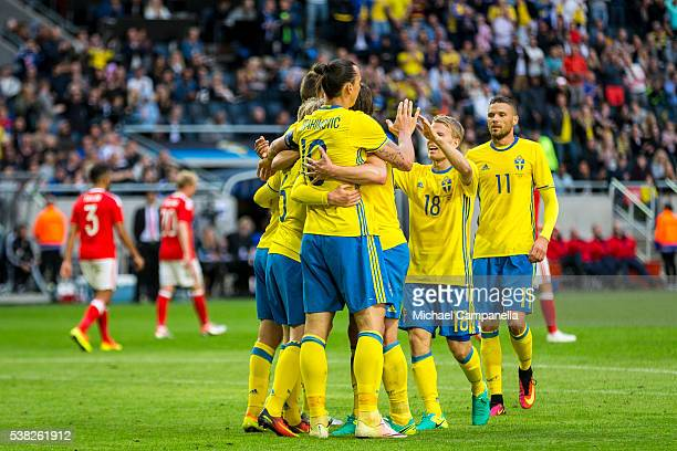 Emil Forsberg of Sweden celebrates with Zlatan Ibrahimovic and teammates after scoring the opening goal during an international friendly between...