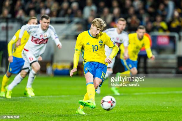 Emil Forsberg of Sweden scores the 10 goal from a penalty during the FIFA 2018 World Cup Qualifier between Sweden and Belarus at Friends arena on...