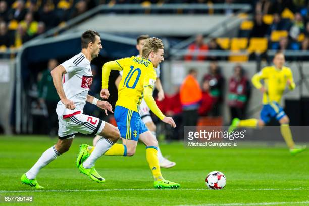 Emil Forsberg of Sweden skips past Yegor Filipenko of Belarus during the FIFA 2018 World Cup Qualifier between Sweden and Belarus at Friends arena on...