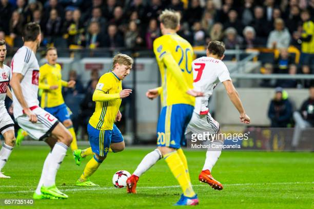 Emil Forsberg of Sweden takes on Aleksandr Martynovich of Belarus during the FIFA 2018 World Cup Qualifier between Sweden and Belarus at Friends...