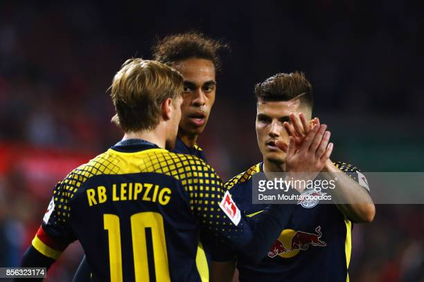 Emil Forsberg Yussuf Poulsen and Marcel Sabitzer of RB Leipzig celebrate after victory in the Bundesliga match between 1 FC Koeln and RB Leipzig at...