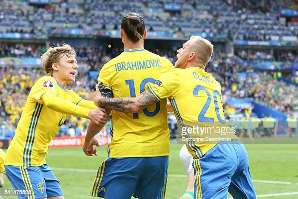 Emil Forsberg Zlatan Ibrahimovic and John Guidetti of Sweden celebrate after Republic of Ireland scored an own goal to make 11 during the UEFA EURO...