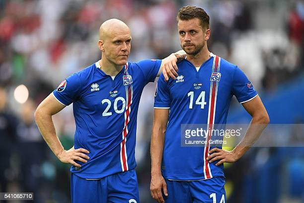 Emil Hallfredsson and Kari Arnason of Iceland look dejected after conceding a late goal during the UEFA EURO 2016 Group F match between Iceland and...