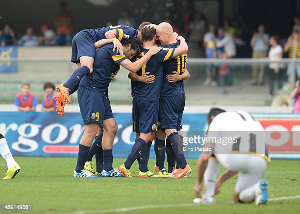 Emil Hallfredsson of Hellas Verona is mobbed by team mates after scoring his team's second goal during the Serie A match between Hellas Verona FC and...