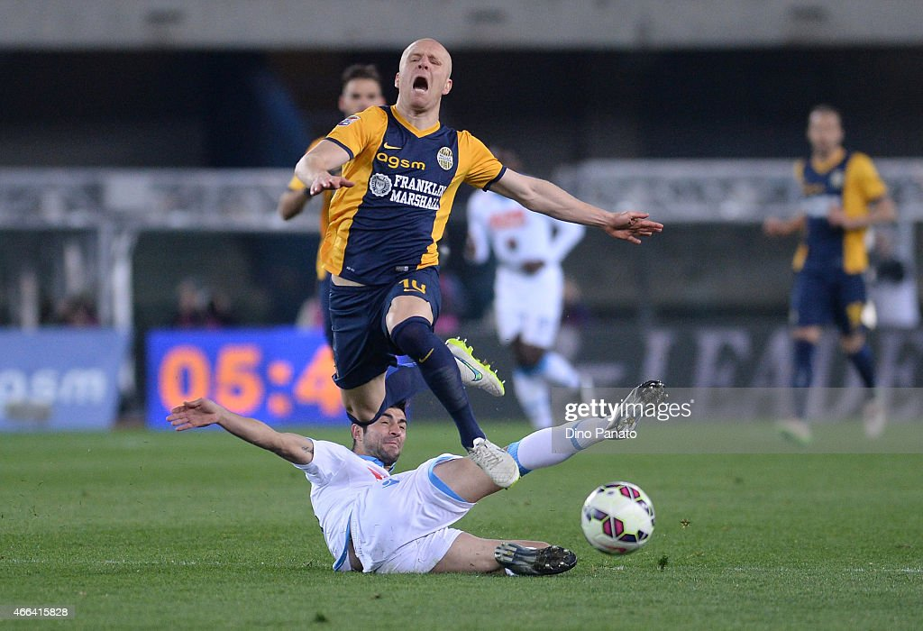 Emil Hallfredsson of Hellas Verona is tackled to Giandomenico Mesto of SSC Napoli during the Serie A match between Hellas Verona FC and SSC Napoli at Stadio Marc'Antonio Bentegodi on March 15, 2015 in Verona, Italy.