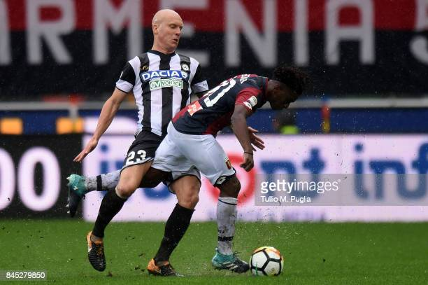 Emil Hallfredsson of Udinese and Sthepane Omeonga of Genoa compete for the ball during the Serie A match between Udinese Calcio and Genoa CFC at...