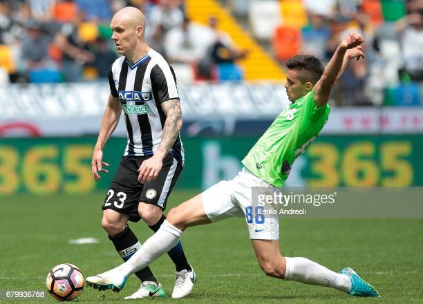 Emil Hallfredsson of Udinese Calcio competes for the ball with Alberto Grassi of Atalanta BC during the Serie A match between Udinese Calcio and...
