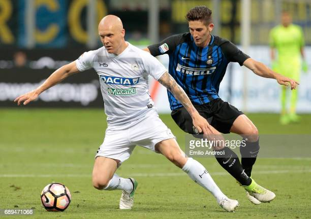 Emil Hallfredsson of Udinese Calcio competes for the ball with Roberto Gagliardini of FC Internazionale Milano during the Serie A match between FC...