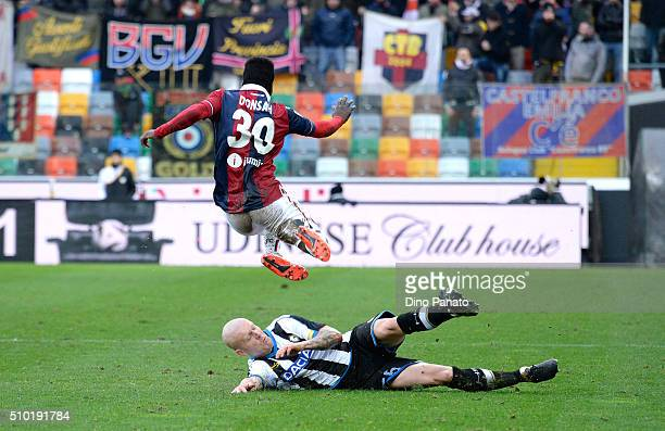 Emil Hallfredsson of Udinese Calcio competes with Godferd Donsa of Bologna FC during the Serie A match between Udinese Calcio and Bologna FC at...