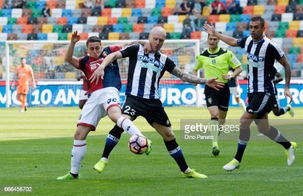 Emil Hallfredsson of Udinese Calcio competes with Leonardo Morosini of Genoa CFC during the Serie A match between Udinese Calcio and Genoa CFC at...