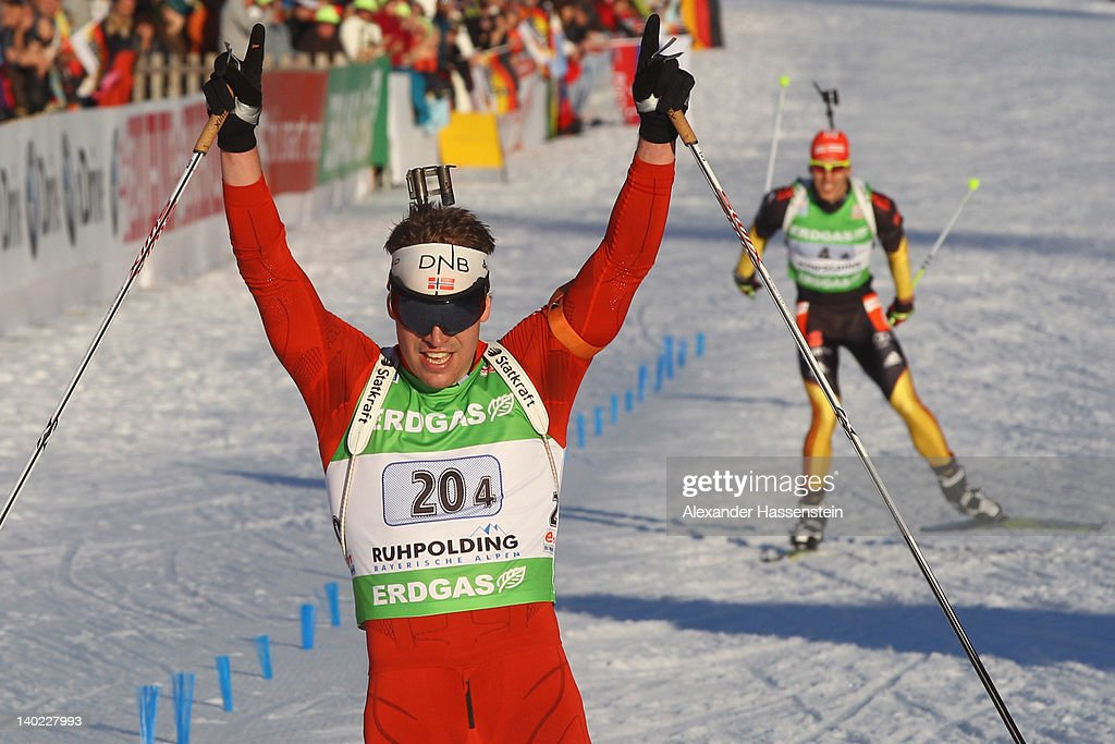 Emil Hegle Svendsen of Norway celebrates at the finsih line ahead of Arnd Peiffer of Germany during the IBU Biathlon World Championships Mixed Relay...