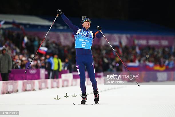 Emil Hegle Svendsen of Norway celebrates winning gold in the 2 x 6 km Women 2 x 7 km Men Mixed Relay during day 12 of the Sochi 2014 Winter Olympics...