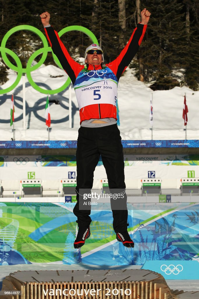 <a gi-track='captionPersonalityLinkClicked' href=/galleries/search?phrase=Emil+Hegle+Svendsen&family=editorial&specificpeople=831528 ng-click='$event.stopPropagation()'>Emil Hegle Svendsen</a> of Norway celebrates winning the gold medal during the flower ceremony for the Biathlon Men's 120 km individual on day 7 of the 2010 Vancouver Winter Olympics at Whistler Olympic Park Biathlon Stadium on February 18, 2010 in Whistler, Canada