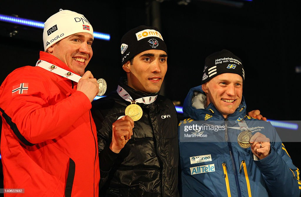 <a gi-track='captionPersonalityLinkClicked' href=/galleries/search?phrase=Emil+Hegle+Svendsen&family=editorial&specificpeople=831528 ng-click='$event.stopPropagation()'>Emil Hegle Svendsen</a> of Norway (silver), <a gi-track='captionPersonalityLinkClicked' href=/galleries/search?phrase=Martin+Fourcade&family=editorial&specificpeople=5656850 ng-click='$event.stopPropagation()'>Martin Fourcade</a> of France (gold) and <a gi-track='captionPersonalityLinkClicked' href=/galleries/search?phrase=Carl+Johan+Bergman&family=editorial&specificpeople=729358 ng-click='$event.stopPropagation()'>Carl Johan Bergman</a> of Sweden (bronze) pose with their medal at the medal ceremony for the IBU Biathlon World Championships Men's 10km Sprint on March 3, 2012 in Ruhpolding, Germany.