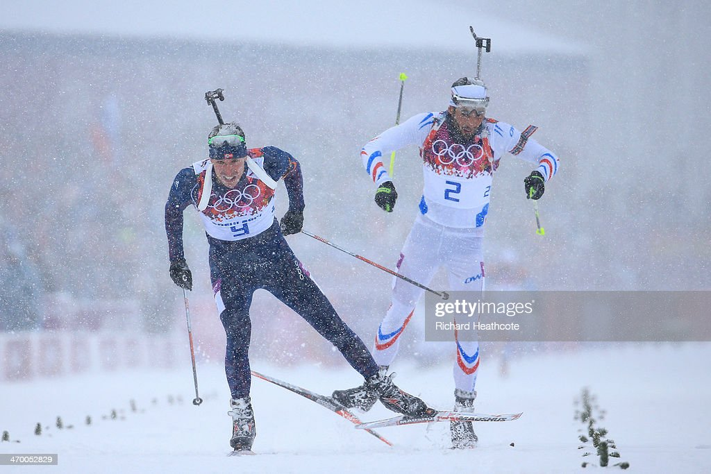 <a gi-track='captionPersonalityLinkClicked' href=/galleries/search?phrase=Emil+Hegle+Svendsen&family=editorial&specificpeople=831528 ng-click='$event.stopPropagation()'>Emil Hegle Svendsen</a> of Norway (L) races to the line to win gold ahead of <a gi-track='captionPersonalityLinkClicked' href=/galleries/search?phrase=Martin+Fourcade&family=editorial&specificpeople=5656850 ng-click='$event.stopPropagation()'>Martin Fourcade</a> of France in the Men's 15 km Mass Start during day 11 of the Sochi 2014 Winter Olympics at Laura Cross-country Ski & Biathlon Center on February 18, 2014 in Sochi, Russia.