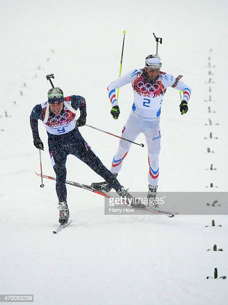 Emil Hegle Svendsen of Norway races to the line to win gold ahead of Martin Fourcade of France in the Men's 15 km Mass Start during day 11 of the...