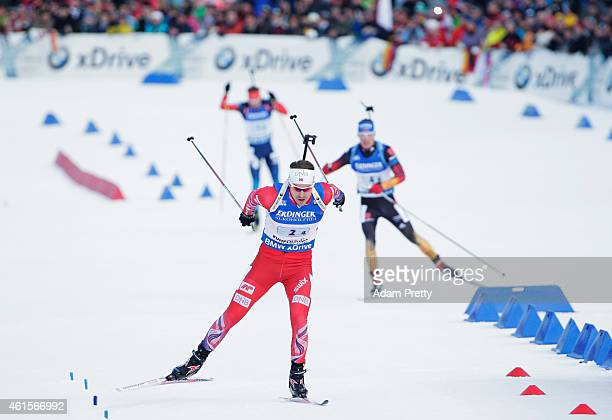 Emil Hegle Svendsen of Norway races to victory infront of Germany and Russia during the IBU Biathlon World Cup Men's Relay on January 15 2015 in...