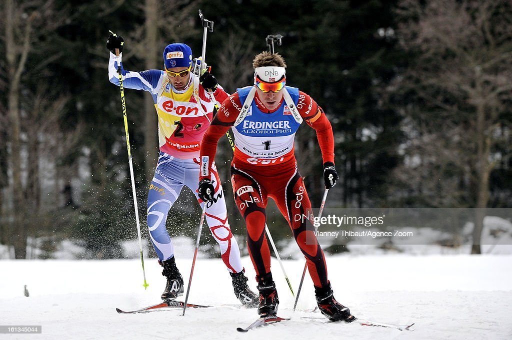 Emil Hegle Svendsen of Norway skies on his way to 1st place ahead of second placed Martin Fourcade (L) of France during the IBU Biathlon World Championship Men's 12.5km Pursuit on February 10, 2013 in Nove Mesto, Czech Republic.