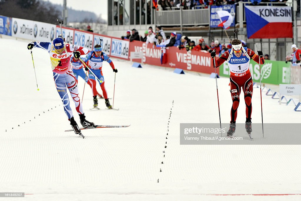 Emil Hegle Svendsen (R) of Norway takes 1st place ahead of Martin Fourcade (L) of France takes 2nd place and Anton Shipulin (2nd R) of Russia takes 3rd place as they sprint for the finish line during the IBU Biathlon World Championship Men's 12.5km Pursuit on February 10, 2013 in Nove Mesto, Czech Republic.