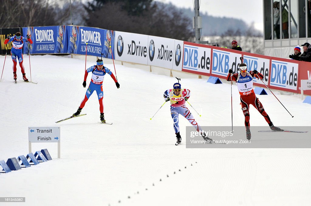 Emil Hegle Svendsen (R) of Norway takes 1st place ahead of Martin Fourcade (C) of France takes 2nd place and Anton Shipulin (L) of Russia takes 3rd place as they sprint for the finish line during the IBU Biathlon World Championship Men's 12.5km Pursuit on February 10, 2013 in Nove Mesto, Czech Republic.