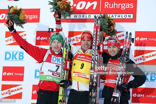 Emil Hegle Svendsen of Norway takes 1st place Simon Eder of Austria takes 2nd place and Ole Einar Bjoerndalen of Norway takes 3rd place during the...