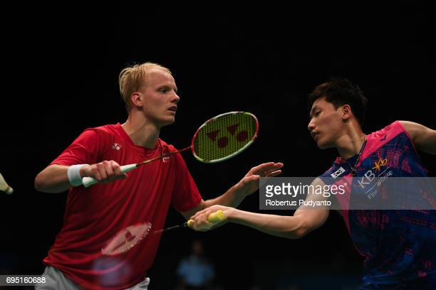 Emil Holst of Denmark competes against Lee Dong Keun of Korea during Mens single qualification round match of the BCA Indonesia Open Super Series...