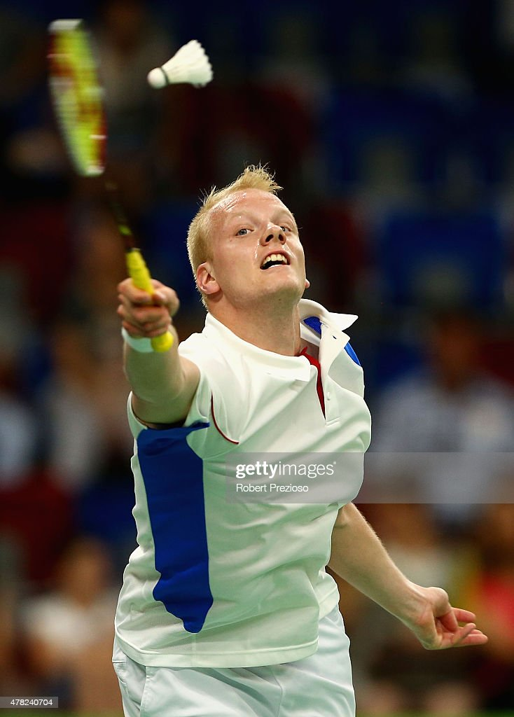 Emil Holst of Denmark competes against Lucas Corvee of France in the Badminton Men's Singles Group H match during day twelve of the Baku 2015...