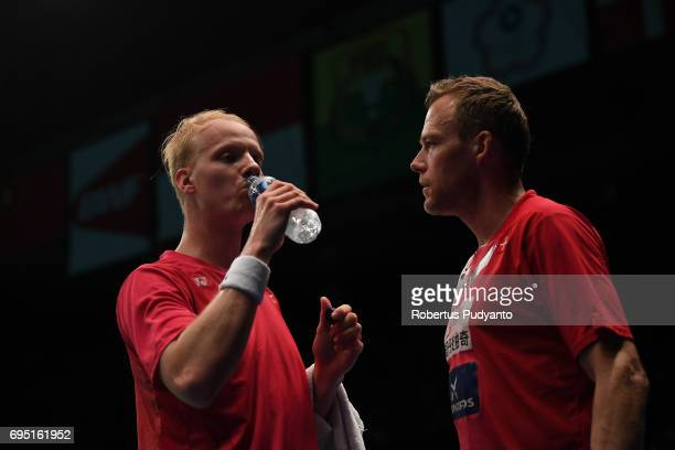 Emil Holst of Denmark drinks as he compete against Lee Dong Keun of Korea during Mens single qualification round match of the BCA Indonesia Open...