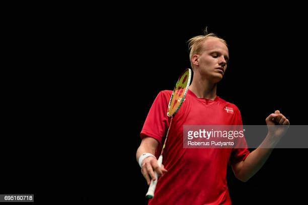 Emil Holst of Denmark reacts as he compete against Lee Dong Keun of Korea during Mens single qualification round match of the BCA Indonesia Open...