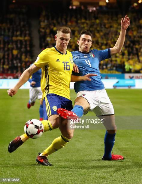 Emil Krafth of Sweden and Matteo Darmian of Italy battle for possession during the FIFA 2018 World Cup Qualifier PlayOff First Leg between Sweden and...